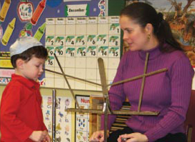 Ms. Lessure teaching a young student.
